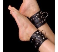 Черные лакированные поножи с заклепками Toyfa