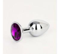 Небольшая серебрянная пробка с фиолетовым кристаллом